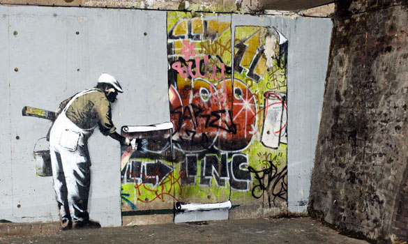 Street fight culture shock art for Banksy mural painted over