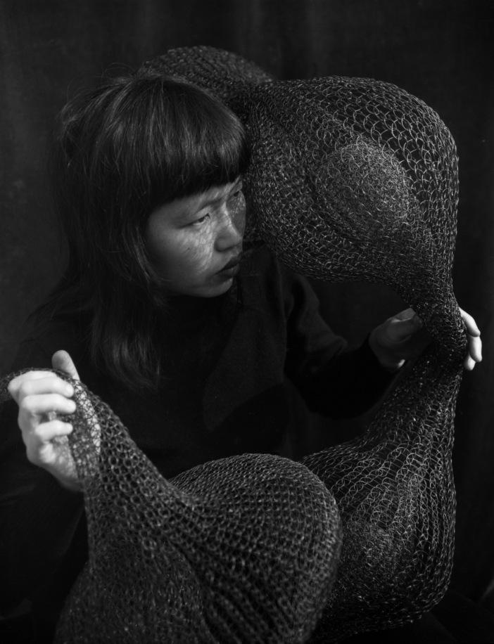 2013-05-07-RuthAsawaSculptor1956RuthHoldingaFormWithinForm1952_.jpg